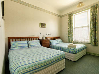 photo of the double-glazed Green Room on the ground floor at the west side of Amber House showing the TWO Queen Beds 
