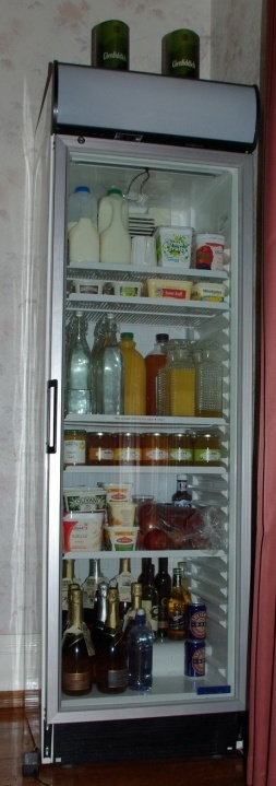 Photo of the glass fronted fridge in the dining room from which guests can help themselves to juices